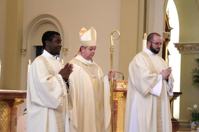 Deacon Immanuel, Bishop Medley, and Deacon Will, after the diaconate ordinations, last may.