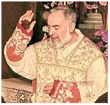 Padre Pio, giving the blessing at Mass with his stigmata on his hands exposed.