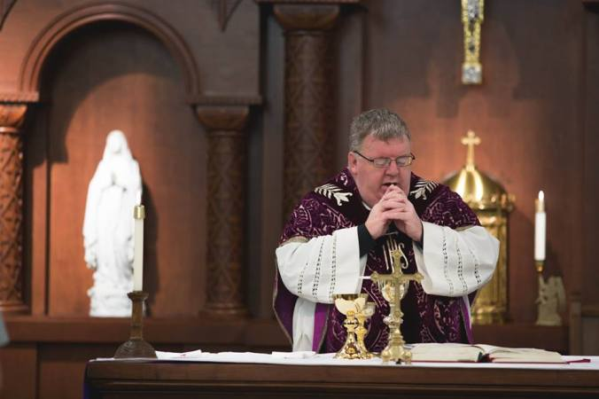 Fr. Bob Robeson, Rector of Bishop Bruté, celebrates Mass during Lent.