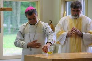 The Bishop anointing the Altar with Sacred Chrism