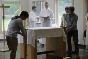 Ian (left) and Mason (right) place the Candlesticks by the Altar