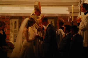 The Bishop sealing their love with his stole, the sign of his office.